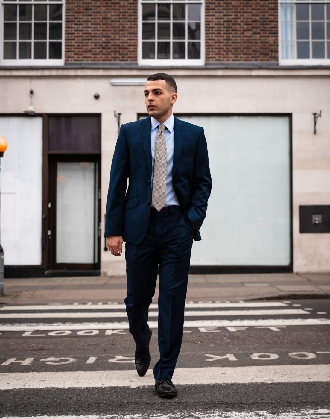 Nickson Shirt Model on zebra crossing wearing a blue slim fit shirt and Business Suit