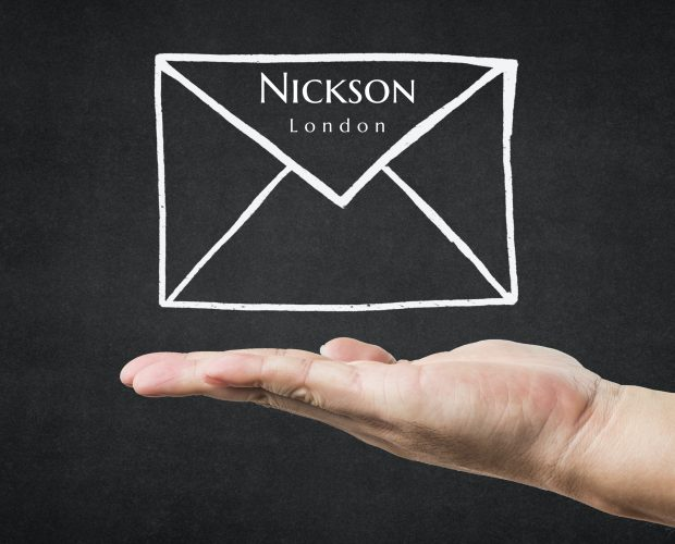 Nickson branded envelope with hand presenting it