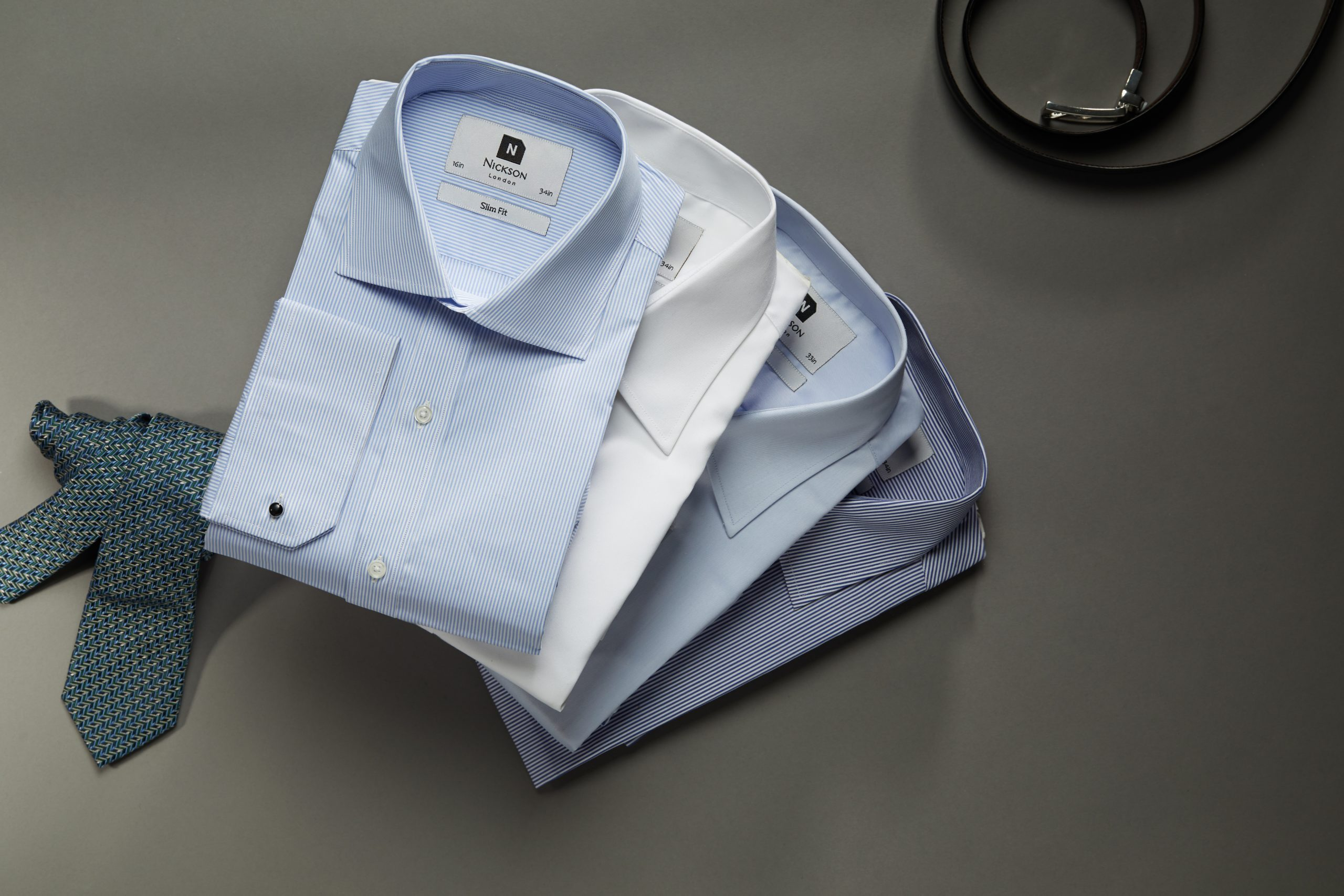 Men's dress shirts, men's tie, men's belt - fanned with white shirt and blue shirts