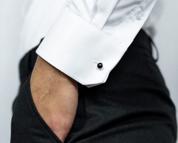 Nickson how to iron a white shirt. Men's white shirt cufflink and focus on arm of man