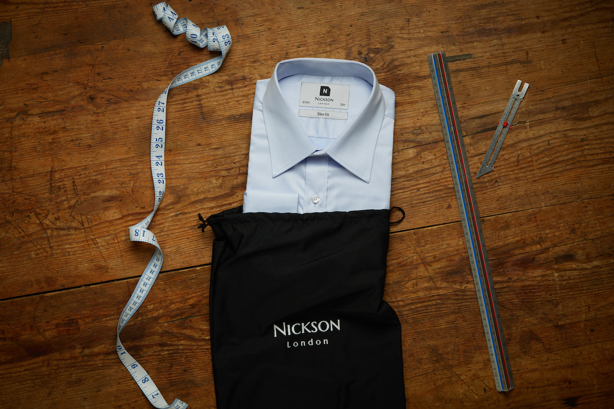 Formal Straight Point Collar Slim Fit Shirt Light Blue on vintage background with measuring tape.