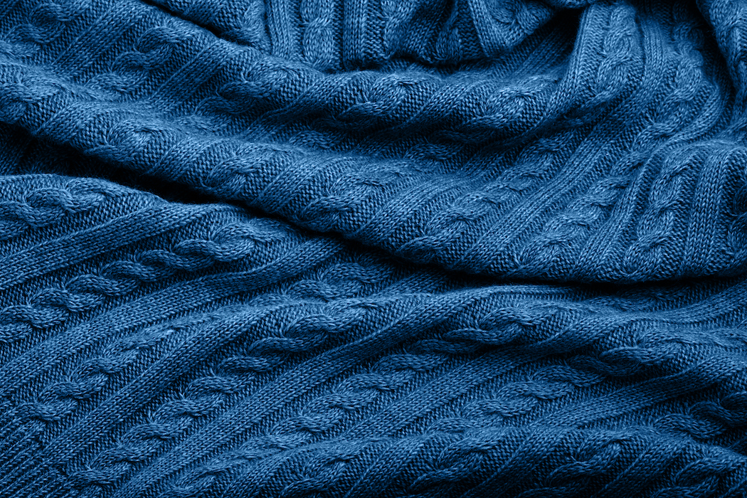 Folds of the best knitwear, blue color, top view